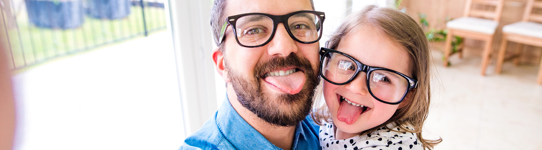 father and child wearing glasses
