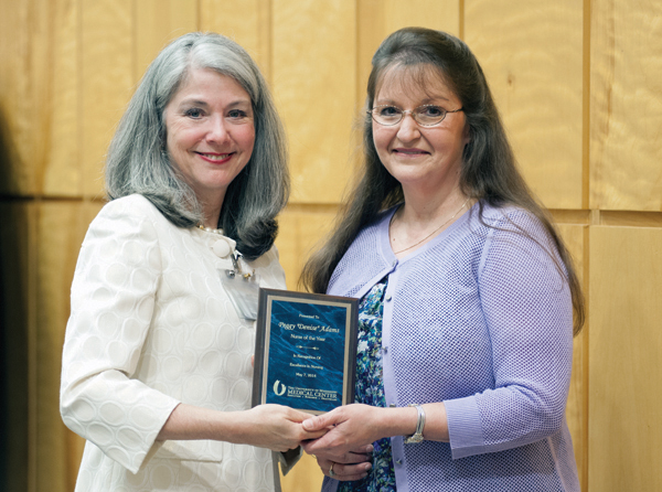 Dr. Janet Harris, left, associate dean for practice and community engagement in the School of Nursing, presents the 2014 Nurse of the Year Award to Denise Adams, a nurse in the pediatric emergency department.
