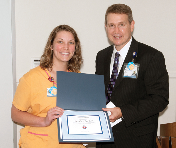 Candice Barber is recognized for her thoughtfulness and hard work by Guy Giesecke.