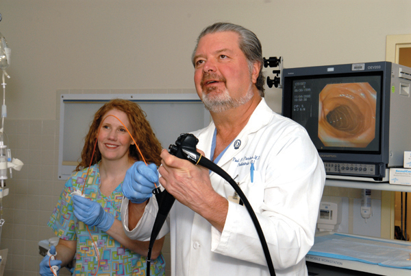 Parker and nurse Suzanne Deaton perform an endoscopy in 2008 at the gastroenterology lab at Batson Children's Hospital.