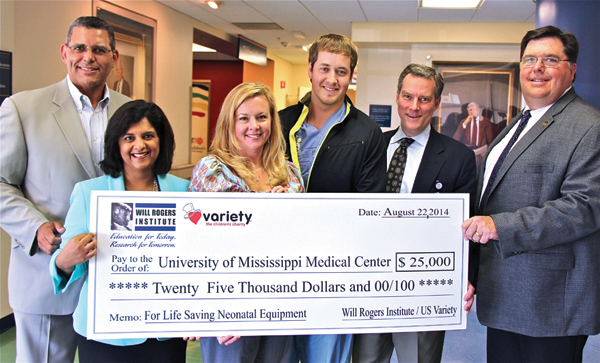 Todd Vradenburg, left, and Ron Krueger II, right, present a $25,000 grant to, from left, Dr. Sajani Tipnis, Tara Goddard, clinical director of the Newborn Center and Center for Maternal & Fetal Care, Billy Needham and Dr. Rick Barr.