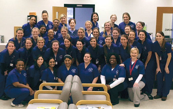 Dental hygiene students strike a pose before embracing the challenges of a rigorous academic schedule.