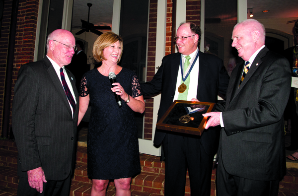 Dr. Ed Harmon, second from right, is honored as the first James E. Keeton, M.D. Chair of Pediatric Urology. Celebrating with him are, from left, Keeton; Dr. LouAnn Woodward, vice chancellor for health affairs and dean of the School of Medicine; and Dr. Dan Jones, chancellor of Ole Miss.
