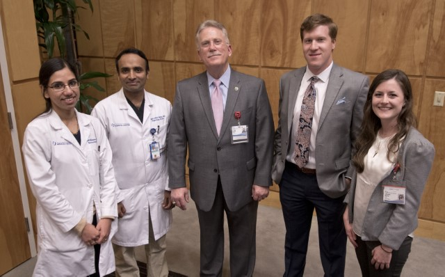 Marshall, center, stands with Department of Medicine award winners, from left, Kumar, Salim, Halinski and Mercier.