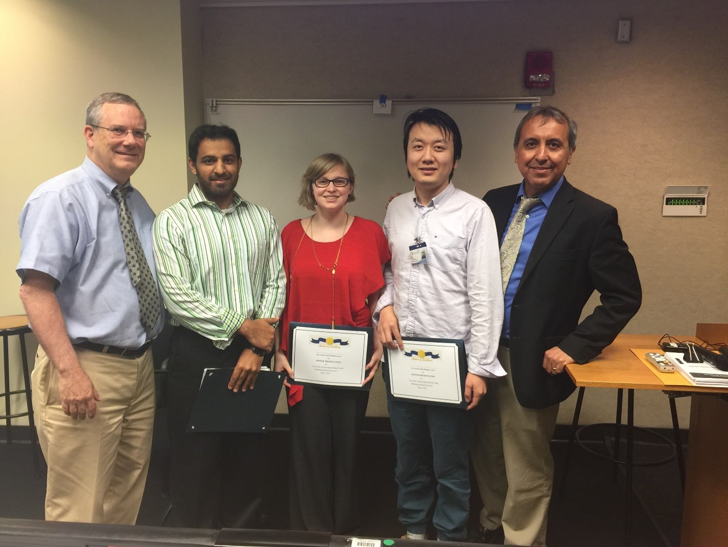 Brodell, left, and Gomez, right, visit with graduate students participating in the event, from left, Nasir Butt, Kathryn Hellman and Lin Wang.