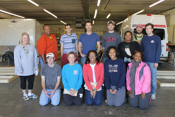 Among the School of Nursing faculty and students participating in a service learning project building sheds for new Habitat for Humanity builds and re-sale houses are, front row from left, Brett Reiter, accelerated B.S.N. student; Kayla King, accelerated B.S.N. student; Tiara Turner, traditional B.S.N. junior; Jalisa Williams, traditional B.S.N. junior; and Monica Wade, administrative assistant in student affairs; and back row from left, Tammy Dempsey, director of student affairs and service learning; Donald Horne, post masters student; Jonathan Smith, accelerated B.S.N. student; Chris Vinson, M.S.N. student, Dalton Montgomery, traditional B.S.N. junior; Amanda Osborne, traditional B.S.N. junior; Sammy Johnson, M.S.N. student; and Bobby Wilkerson, accelerated B.S.N. student.