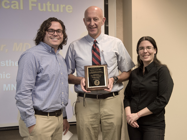 Joyner, center, receives an honorary plaque from PIT leaders John Henry Dasinger and Dr. Carolina Dalmasso.