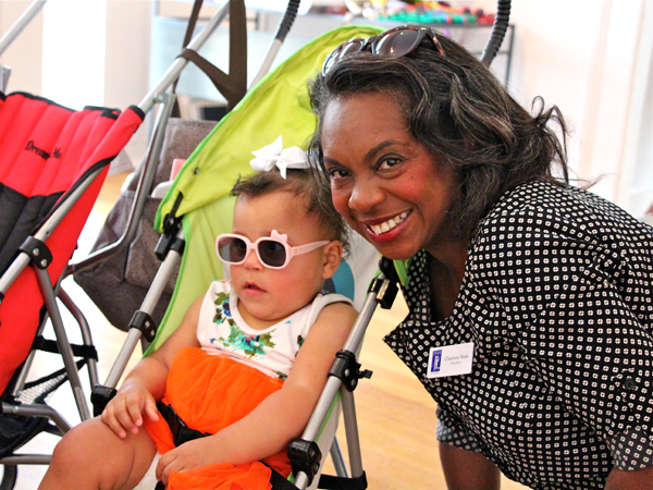 Kenleigh Fugate, one of identical quadruplets born at UMMC, and Charlotte Seals, president of the Junior League of Jackson, share a moment at the Rockin' Mamas Reunion.