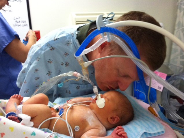 Sybil Cumberland gets a kiss from father Jason Cumberland during her stay at UMMC.