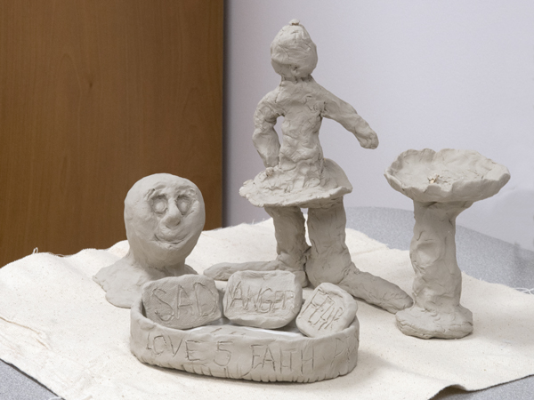 "Clay sculpture created by one patient features literal expressions of emotions -- including ""anger"" and ""fear."""