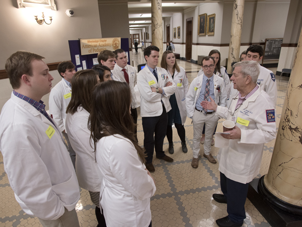 Feldman talks with medical students, residents and fellows at the start of Capitol Day.
