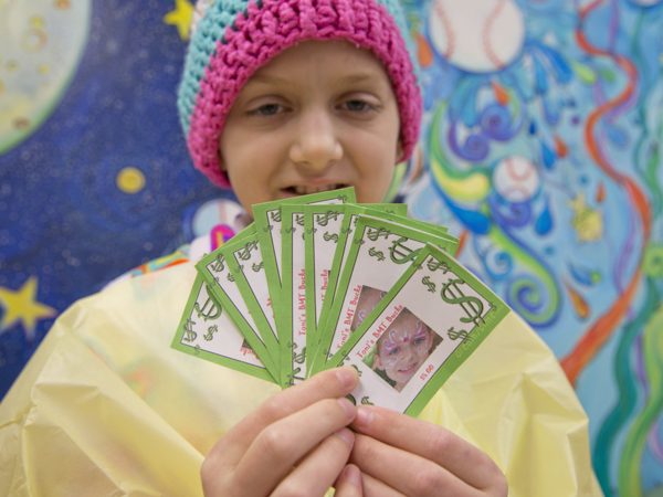 It's pay day for Toni Marino, 11, a participant in the BMT Bucks program at Batson Children's Hospital. Her BMT Bucks feature her photo on each bill.