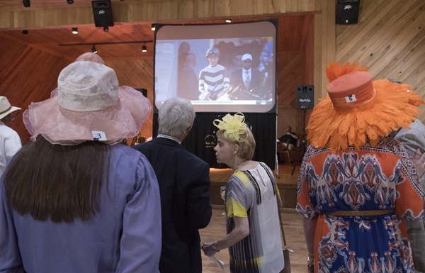"Watching the Kentucky Derby live on a big-screen television was a highlight of the University Transplant Guild's ""Day at the Derby"" fundraiser."