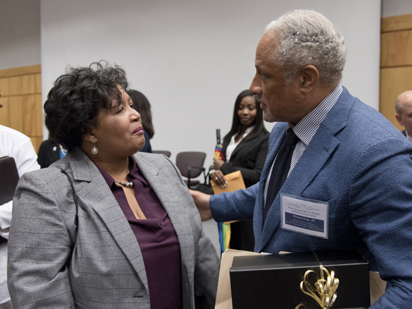 Reena Evers-Everette, left, executive director of the Medgar and Myrlie Evers Institute, has a word with Espy following his presentation.