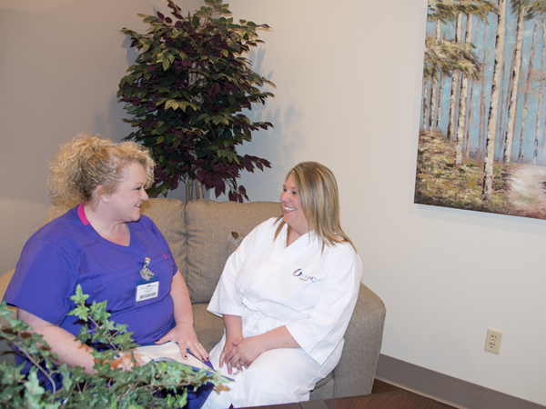 McCammon, left, helps patient Self relax in the Imaging Center's private waiting area for those getting a mammogram.