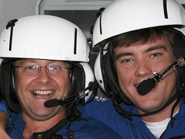 Dr. Damon Darsey, right, was an AirCare paramedic before leaving to go to medical school. Also in this photo taken more than a decade ago is veteran AirCare nurse Bo Sullivan.