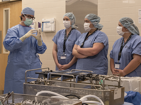 Dr. Truman M. Earl, associate professor of transplant surgery, describes laparoscopic gallbladder surgery to Blaylock, second from left, Howell, second from right, and Price.