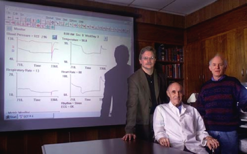 In this 2002 photo, Summers, left, is shown with his  legendary colleagues, Dr. Arthur Guyton, center, and Dr. Thomas Coleman, who together designed a model of integrative human physiology.