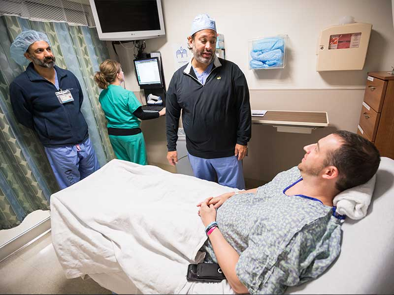 UMMC thoracic surgeon Dr. Pierre de Delva, center, chats with Sands before Sands' recent cancer surgery.