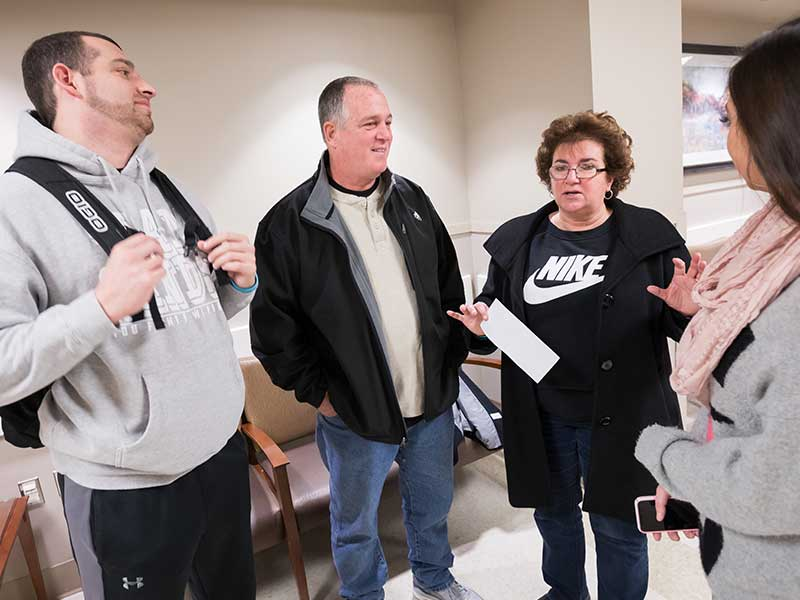Sands, left, visits with his parents, David and Nanci Sands, and girlfriend, Mary Grace Eppes, before his recent cancer surgery at UMMC.