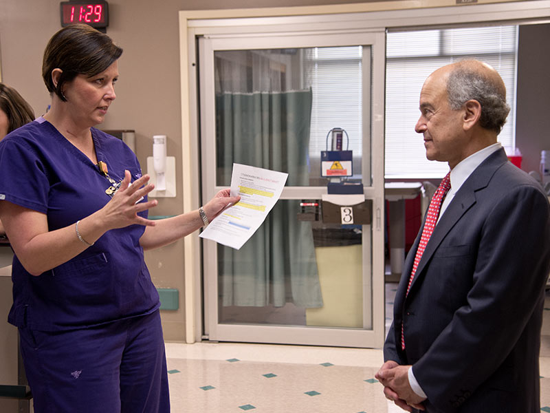 Dr. Mark Chassin, CEO and president of The Joint Commission, talks with surgical ICU nurse manager Kim Horn during his 2015 visit to the Medical Center.