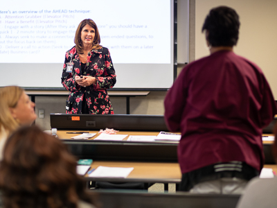 "Class leader Elizabeth Franklin, center, listens as Jessica Eglin, and administrative assistant in the Department of Pediatrics, shares her ""elevator speech"" with the Preparing for Success class."
