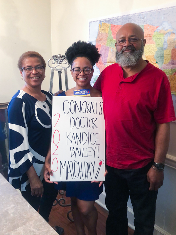Kandice Bailey's parents, KaSandra and Curtis Bailey, help her celebrate Match Day in March.
