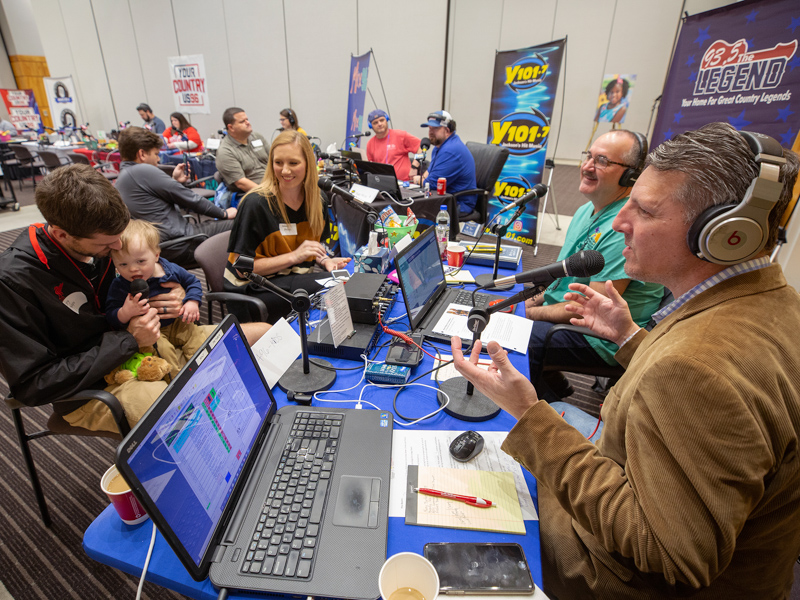 Cory, Ward and Abbey Phillips of Madison share their Children's of Mississippi story with Scott Steele, right, and Mark McCoy of 93.5 The Legend during the 2020 Mississippi Miracles Radiothon.