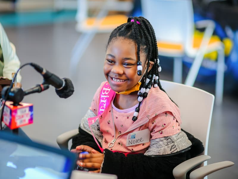 Wearing a birthday sash, Nolee Kelis Jones of Pearl smiles during the first day of the 2021 Mississippi Miracles Radiothon.