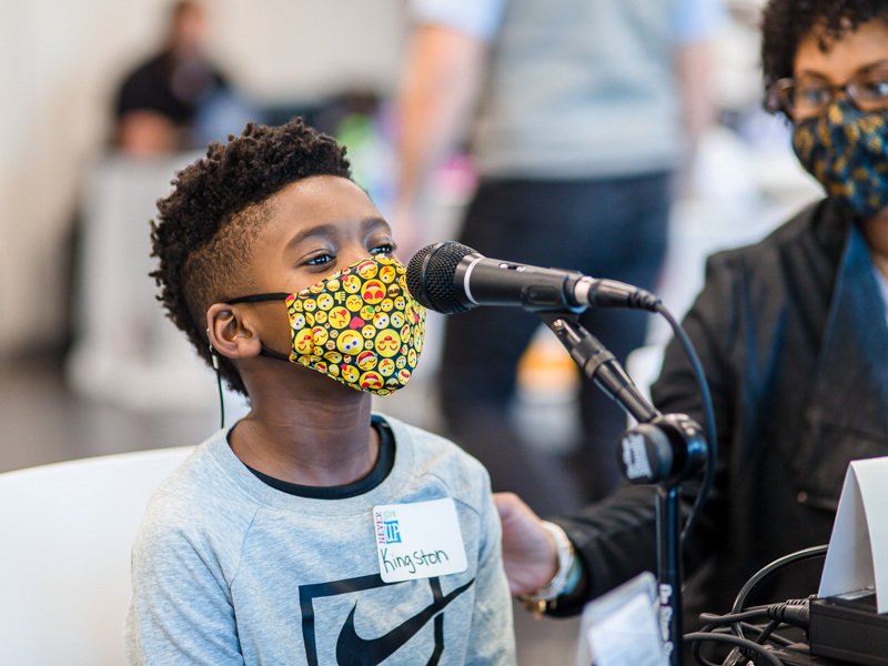 Kingston Murriel of Brandon, a Children's Heart Center patient at Children's of Mississippi, speaks into the microphone during the 20th annual Mississippi Miracles Radiothon.