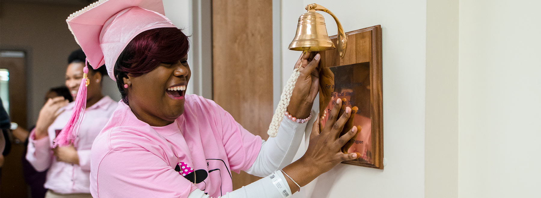 Female patient rings bell signifying her last treatment