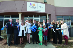 Julie Sparks, nurse coordinator at Children's of Mississippi's new Tupelo specialty clinic, leads a tour during the clinic's January 21, 2015, opening and ribbon-cutting.  It joins other pediatric specialty clinics across the state, including a Gulf Coast clinic that's a partnership with Memorial Hospital.
