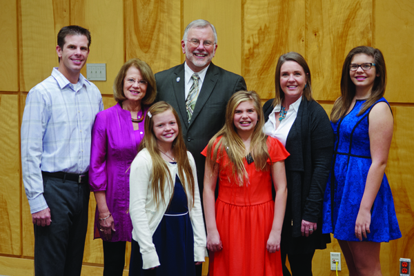 "Dr. Steve Case, back row, center, is surrounded by his family during a reception at UMMC honoring his years of service. With him are, back row, from left, his son Chad Erik Case, wife Gay Lynn Case, daughter-in-law Mary Margaret Case and granddaughter Catherine Bryan ""Kitty"" Case; front row, from left: granddaughters Audrey Davis ""Dee"" Case and Mary McLauren ""Macky"" Case."