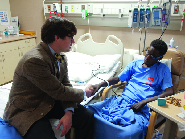 UMMC abdominal transplant surgeon Dr. Mark Earl visits Utica resident Dennis Mitchell, 33, who on April 14 received the 50th  liver transplant since the Medical Center's program was jump-started in March 2013.