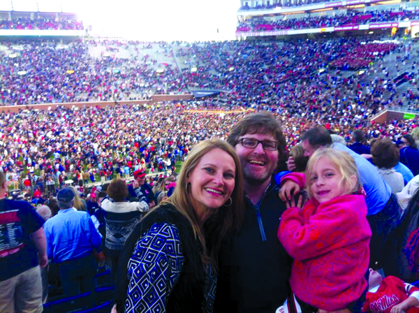 Dr. Jason Murphy, center, with wife Susan and daughter Lydia at the 2014 Ole Miss-Alabama football game