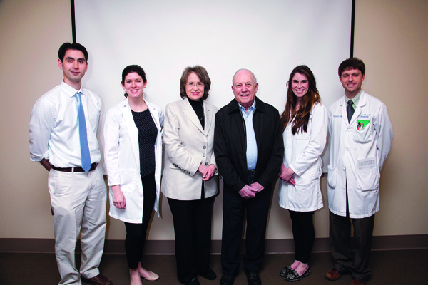 "Dr. Boni Elewski, third from left, professor of dermatology at the University of Alabama at Birmingham, presented the first Louis J. ""Skip"" Wise, M.D. Education Fund Lectureship Feb. 23.  The lectureship is named for Wise, third from right, a longtime Jackson dermatologist who graduated from the Ole Miss Medical School, did residency training at UMMC and taught here for several years. Also attending the event are dermatology house officers, from left, Dr. Michael Cosulich, Dr. Lauren Craig, Dr. Lauren Casamiquela and, far right, Dr. Kenneth Saul. The fund was established to honor Wise's career, commitment and dedication to dermatology in Mississippi. To give to the ""Skip"" Wise Fund, visit https://www.umc.edu/givenow/Default.aspx."