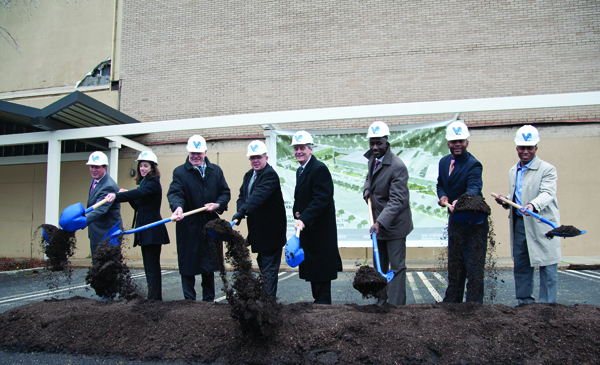 State and city leaders and UMMC representatives join Scott Thompson, fourth from left, founder and CEO of Venyu Solutions, during a February groundbreaking for the Venyu Technology Center, which will include a newly constructed building to be leased by the UMMC Center for Telehealth.