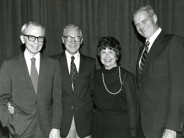 In this undated photo, four members of the original faculty and staff at UMMC reunite. They are, from left: Dr. Peter Blake, the first director of the Introduction to Clinical Medicine course; Dr. Orlando Andy, first head of the Department of Neurosurgery; Irene Graham, UMMC's first librarian; and Dr. Warren Bell, chair of what was then a separate administrative unit: the Department of Clinical Laboratory Sciences, for Clinical Pathology.