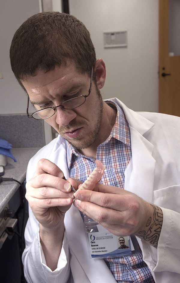 Bowron crafts a dental prostheses.
