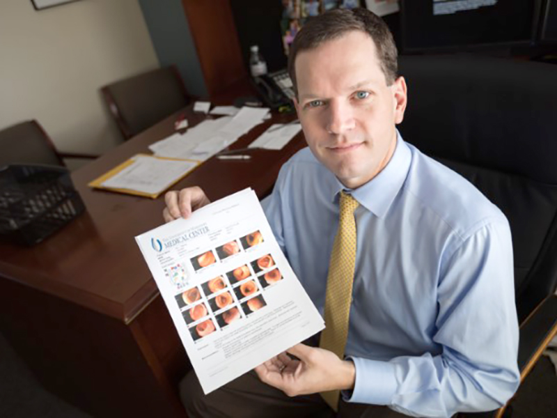 Dr. Shannon Orr, who leads the UMMC Cancer Institute team that treats colon cancer had his colonoscopy early based on a family history of the disease. He shows results here, including photos of a few polyps before they were removed.