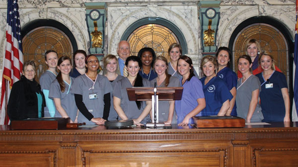 Dental hygiene students visit with state senators Debbie Dawkins, left, and Tommy Gollott, center, during a tour of the Mississippi Capitol Jan. 13.
