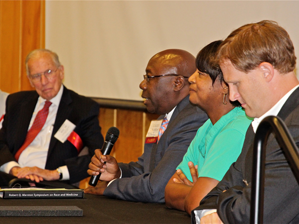 Engaged in a panel discussion during the 2014 Marston Symposium are (from left) former Governor William Winter, Dr. Claude Brunson, UMMC, Dr. Shirley Donelson, Baptist Medical Center, and Dr. Cameron Guild, UMMC.