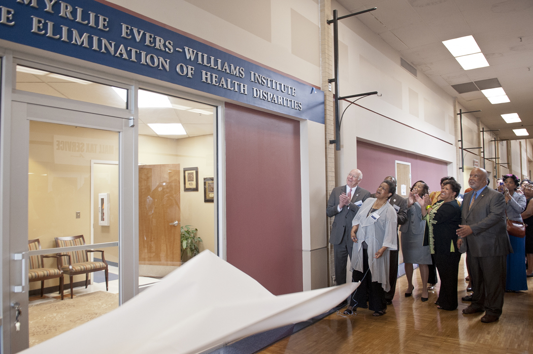 Dr. Myrlie Evers-Williams, foreground, unveils the sign marking the institute.
