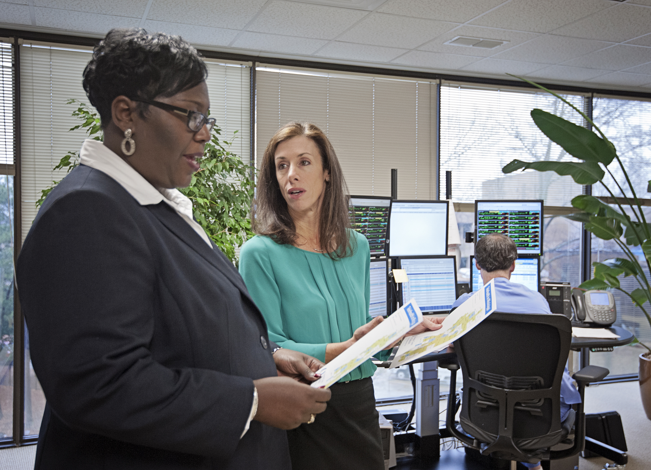 Trina George, left, Mississippi state USDA director of rural development, and Dr. Kristi Henderson, UMMC director of Telehealth and chief advanced practice officer, discuss how the new projects will improve access to care in the state.