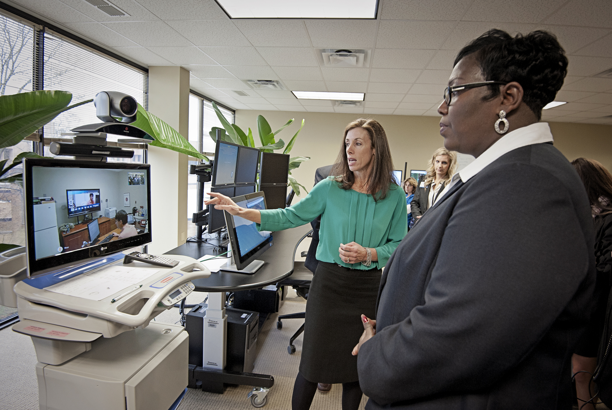 Dr. Kristi Henderson, left, UMMC director of Telehealth and chief advanced practice officer, and Trina George, right, Mississippi state USDA director of rural development, demonstrate a telehealth system.