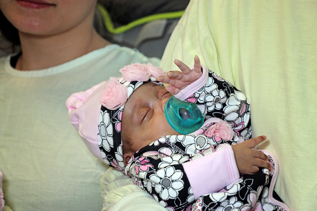 Kelsey Roxanne Fugate snuggles in her dad's arm before her release from the neonatal  intensive care unit at Batson Children's Hospital.