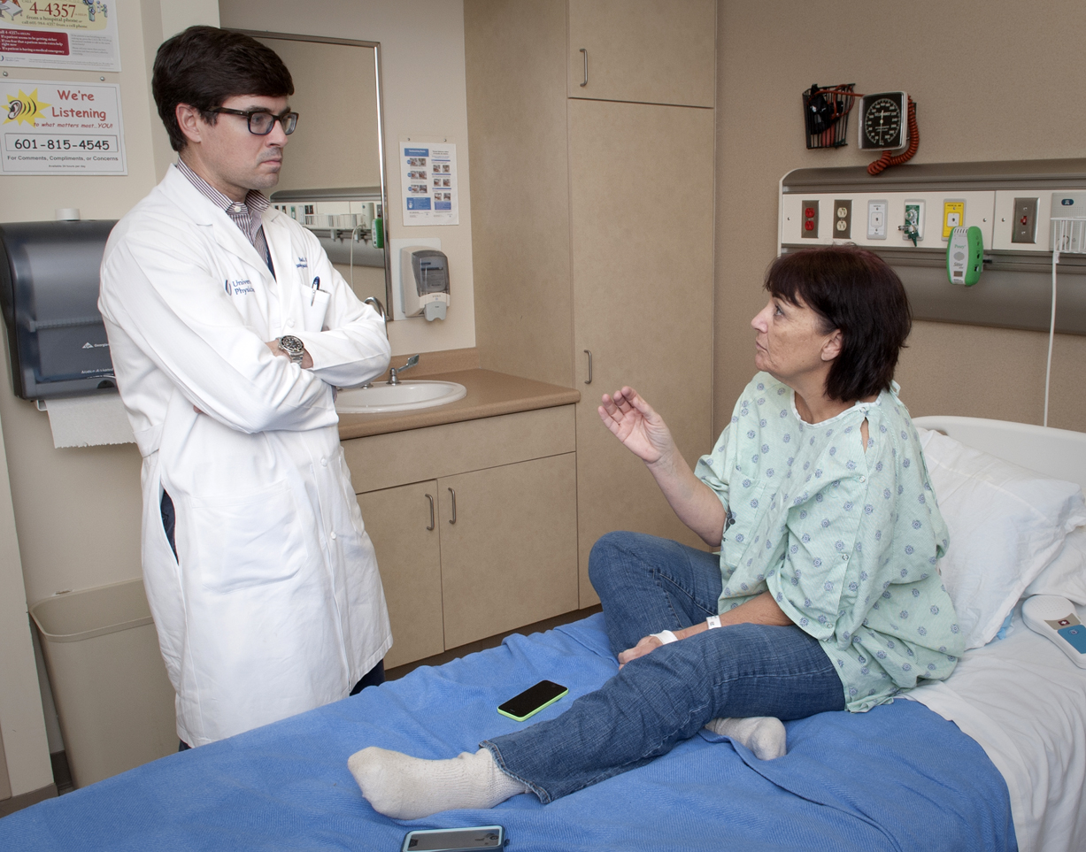 University of Mississippi Medical Center assistant professor of surgery Dr. Mark Earl explains to Jackson resident and diabetic Nancy Smith how he will transplant into her abdomen a donated pancreas.