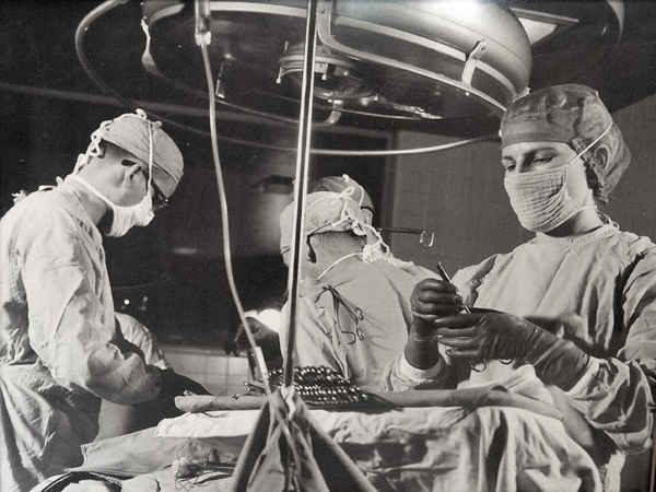 Caracci, foreground, in the OR at UMMC