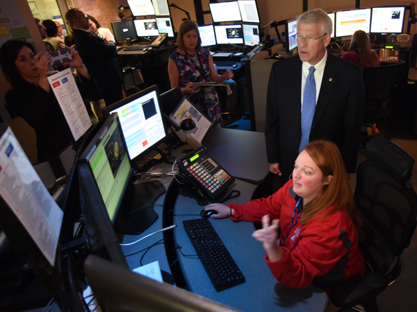 Samantha Tucker, a communications specialist at Mississippi MED-COM, explains to Sen. Wicker how she fields calls from emergency responders statewide.