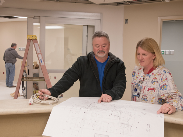 David Walker of S&C Sound and Communications and Lawrence go over plans for renovation of the Lexington hospital's ED.